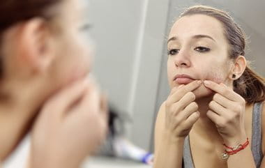 Picking and fiddling with spots can cause acne