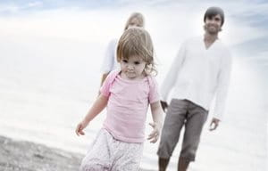 Family walking in the beach