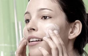 Women using Cleanser on cheeks