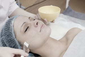 Woman getting a facial chemical peel.